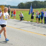Amy Tempel runs along Old Hwy 231 outside of Gentryville.