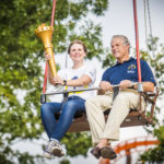 Torchbearer Lauren and state tourism director Mark ride Crow's Nest with the Bicentennial Torch.