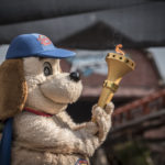 Holidog proudly holds the Indiana Bicentennial Torch inside Holiday World & Splashin' Safari.