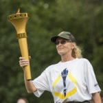 Connie Luthy carries the torch and represents Lincoln Boyhood National Memorial.