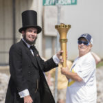 Darlene ran the torch into Rockport to pass off to Charlie Finecy, dressed as Abraham Lincoln.