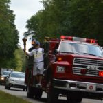 Mr. Heeke rides a New Boston Fire Engine into Lincoln City with the Bicentennial Torch.