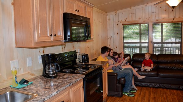 Family in living room at Lake Rudolph cabin