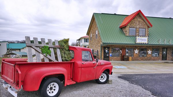 Exterior of Evergreen Boutqiue and Christmas Shop with Red Truck