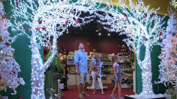 Family visiting Santa Claus Christmas Store