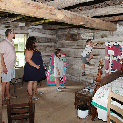 Family touring cabin at Lincoln Pioneer Village & Museum.