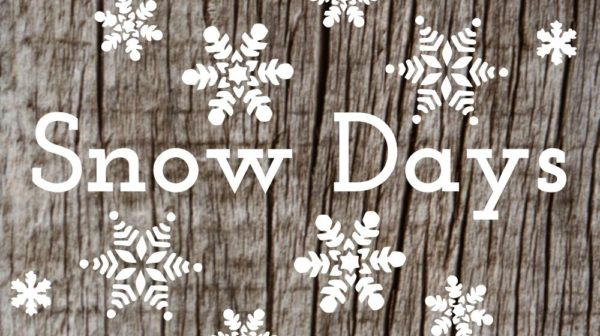 """Wood background with snowflakes and the text """"snow days"""""""