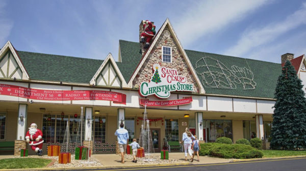 Exterior of Santa Claus Christmas Store with a mom, dad, and children walking up to the entrance